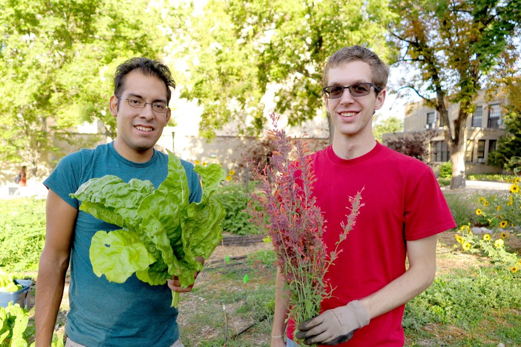 University of Utah students holding what they harvested from the Edible Campus Garden