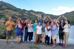 """University of Utah faculty """"throwing up the U"""" while attending the Wasatch Experience."""
