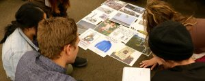 Students work on a project in Professor Adrienne Cachelin's class.