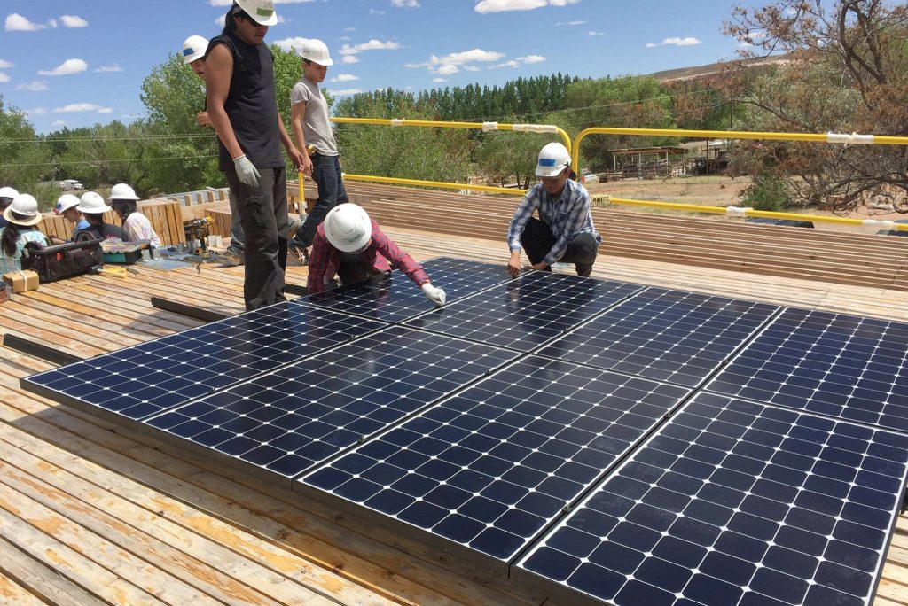 Solars panels are installed as part of Design Build Bluff in Southern Utah. The project was supported by the Sustainable Campus Initiative Fund.