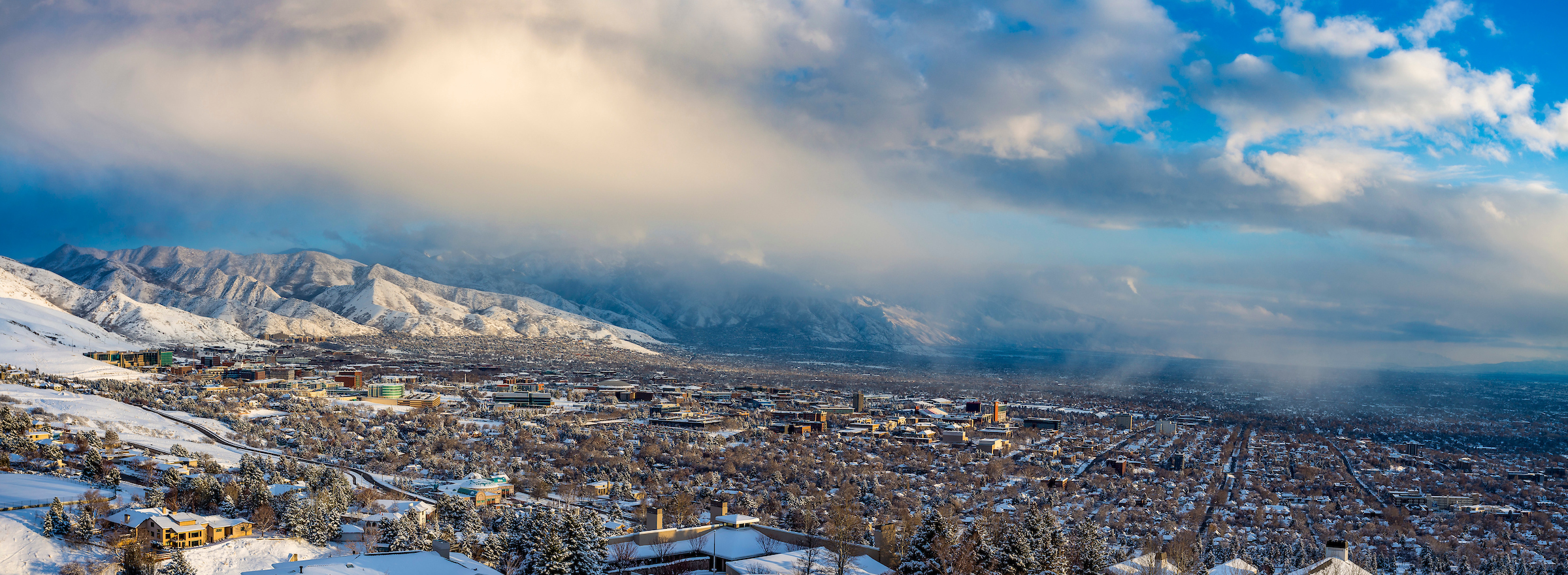 Aerial view of University of Utah campus and mountains in the winter.
